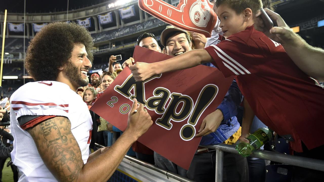 San Francisco 49ers quarterback Colin Kaepernick greets fans after the 49ers 31-21 win over the San Diego Chargers during an NFL preseason football game Thursday, Sept. 1, 2016.