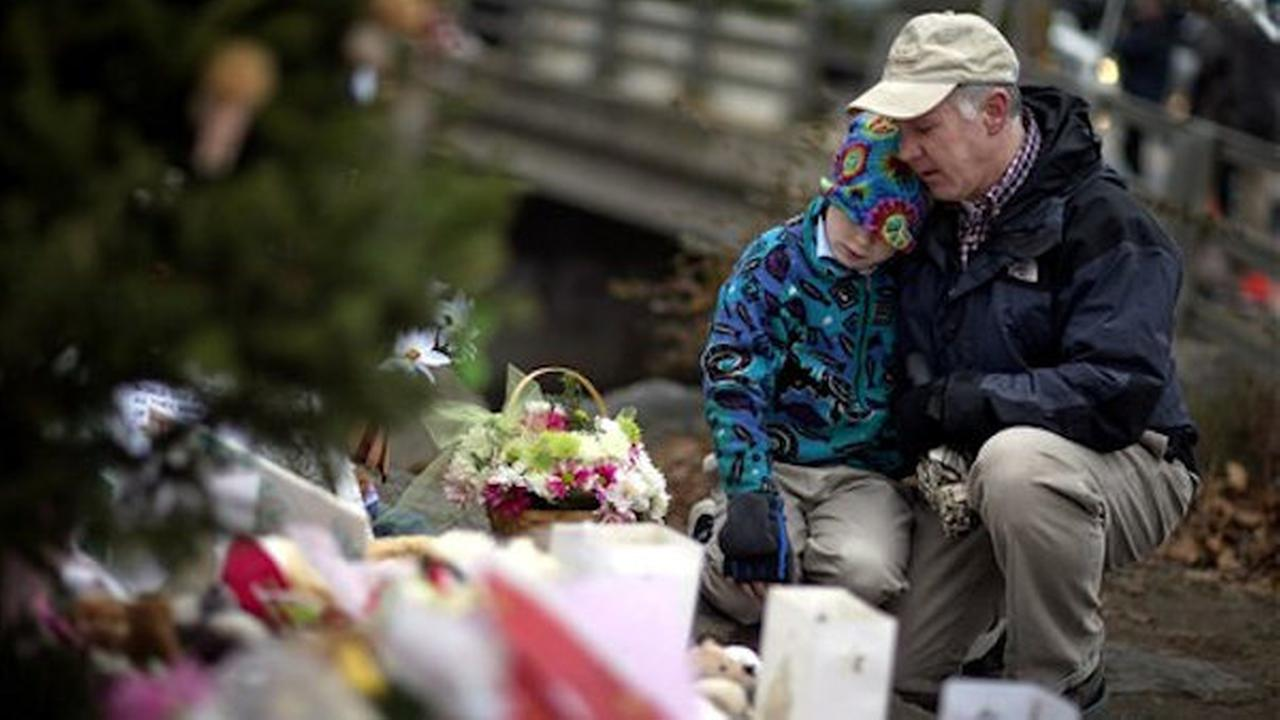 Photos of events following the Newtown school massacre on Friday, December 14, 2012.