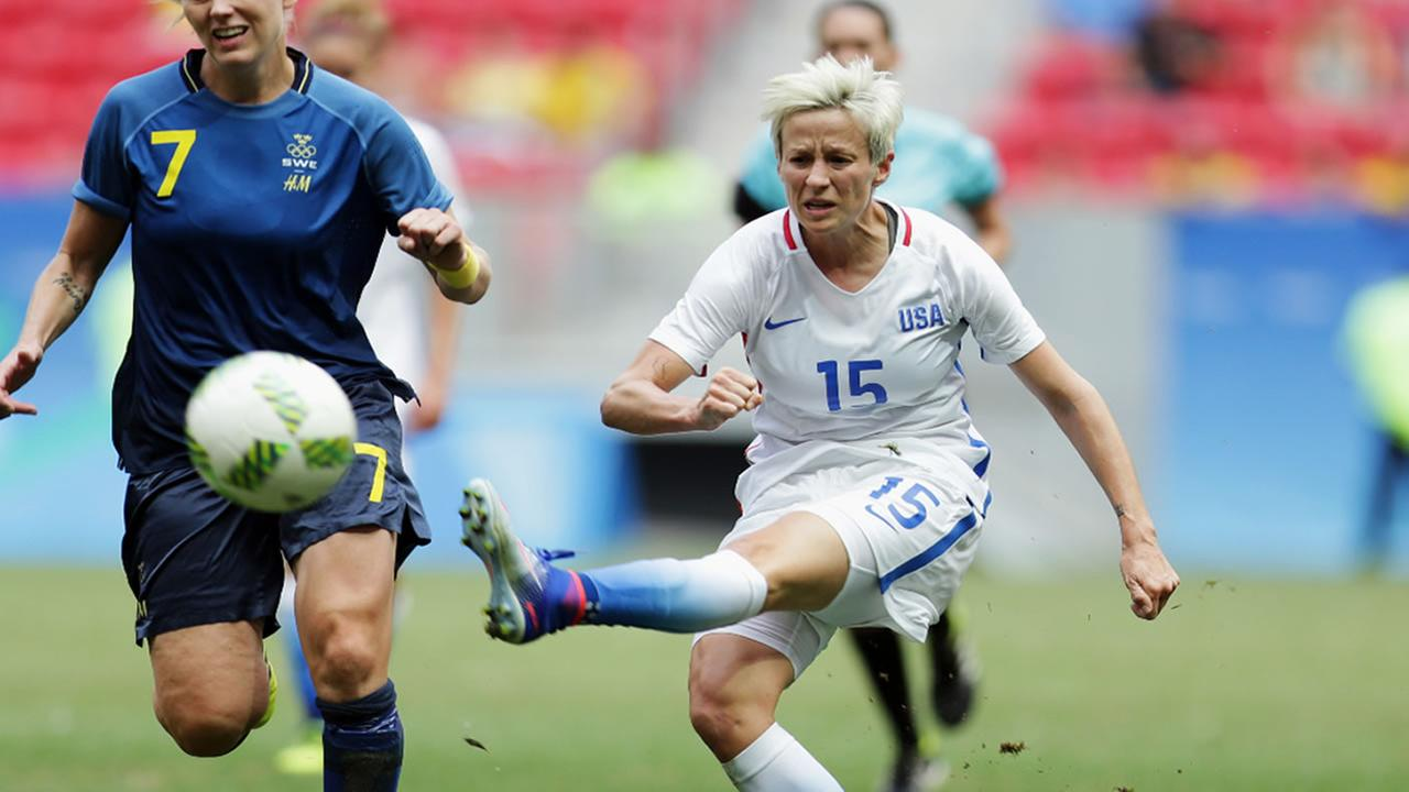 In this Friday, Aug. 12, 2016, file photo, US Megan Rapinoe, right, kicks the ball past Swedens Lisa Dahlkvist during a match of the womens Olympic soccer tournament in Brasilia.