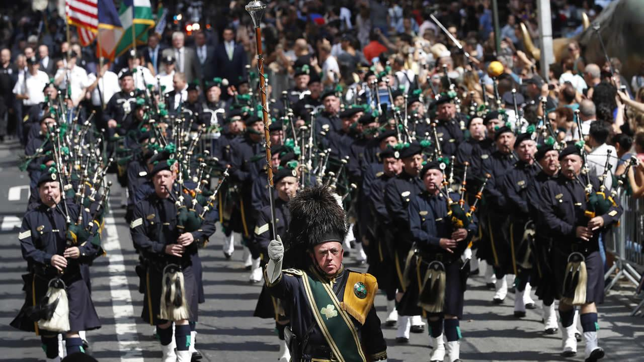 Bagpipers march down Broadway during the NYPD Emerald Society Pipes and Drums memorial procession, Friday, Sept. 9, 2016, in New York.