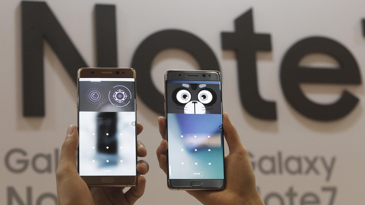 In this Thursday, Aug. 11, 2016, file photo, models display the iris scanner features of the Samsung Galaxy Note 7 smartphones at the companys headquarter in Seoul, South Korea. (AP Photo/Ahn Young-joon. File)
