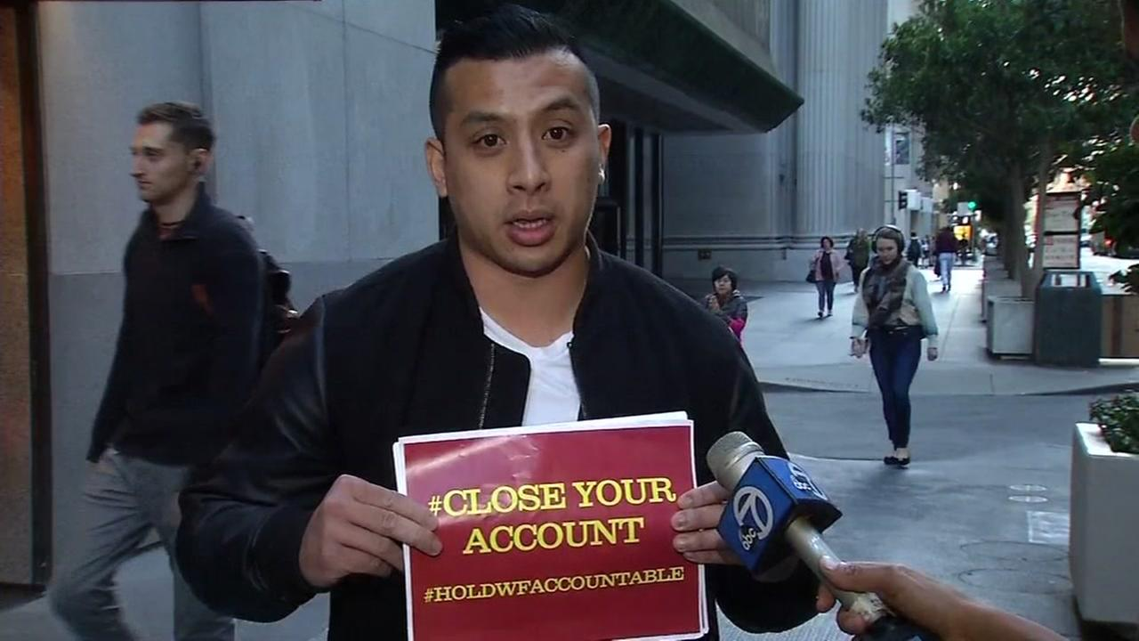 Kevin Pham stands in protest against Wells Fargo in San Francisco on Friday, September 23, 2016.