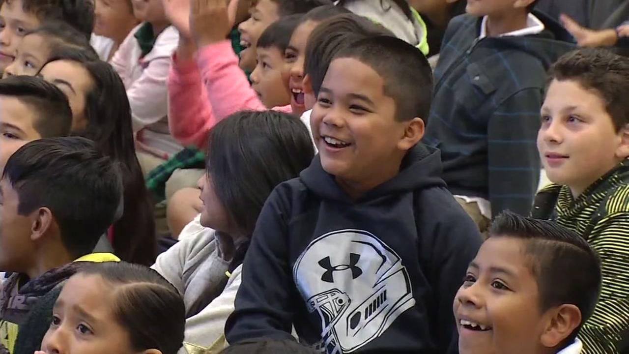 Boy at Meadows Elementary School in San Jose celebrates after learning his school will receive iPads, Friday, September 23, 2016.