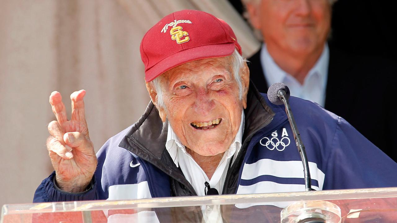 Louis Zamperini gestures during a news conference Friday May 9, 2014 in Pasadena, Calif. The World War II hero and former Olympian has died at the age of 97.