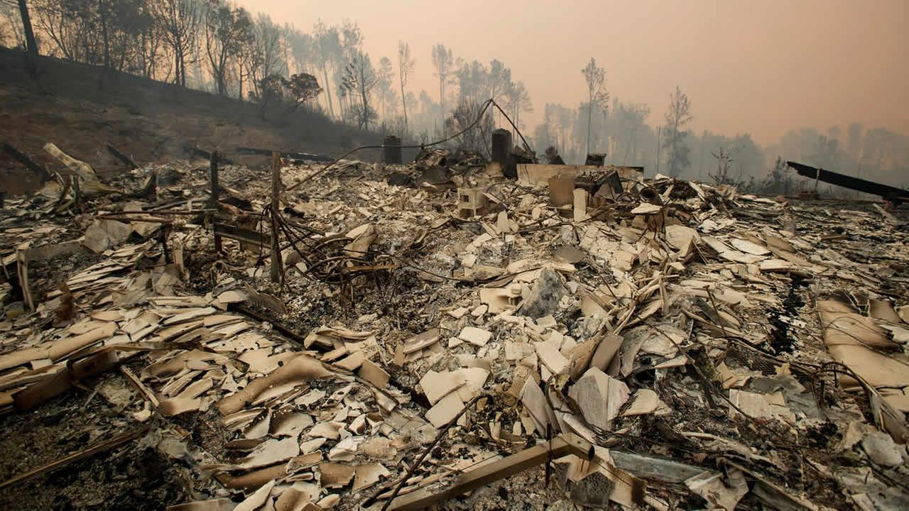 Rubble lines a residence leveled by the Loma fire along Loma Chiquita Road on Tuesday, Sept. 27, 2016, near Morgan Hill, Calif.