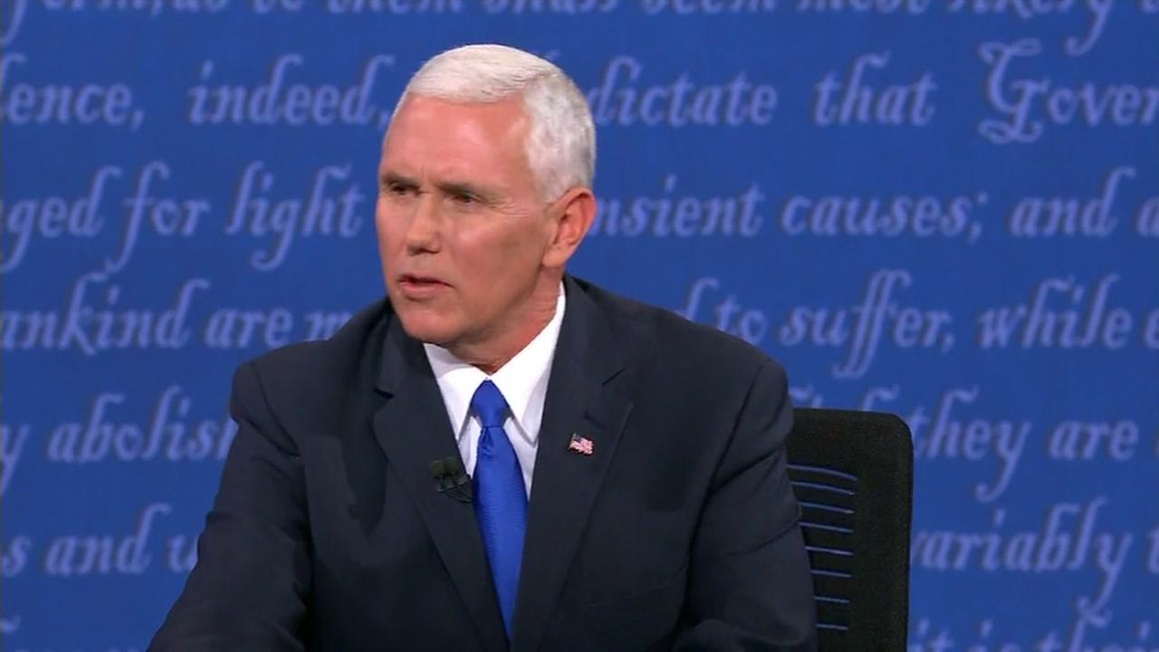 Mike Pence sits at the desk during the vice presidential debate at Longwood University in Farmville, Va. on Oct. 4, 2106.