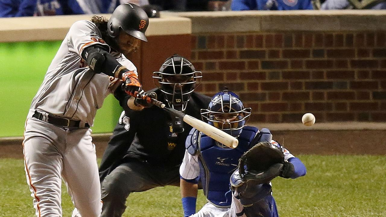 San Francisco Giants Brandon Crawford (35) hits a single in Game 2 of baseballs National League Division Series against the Chicago Cubs, Saturday, Oct. 8, 2016.
