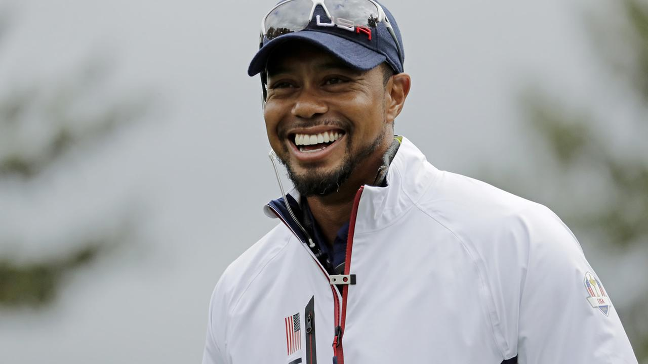 United States vice-captain Tiger Woods smiles during a practice round for the Ryder Cup golf tournament Wednesday, Sept. 28, 2016, at Hazeltine National Golf Club in Chaska, Minn.