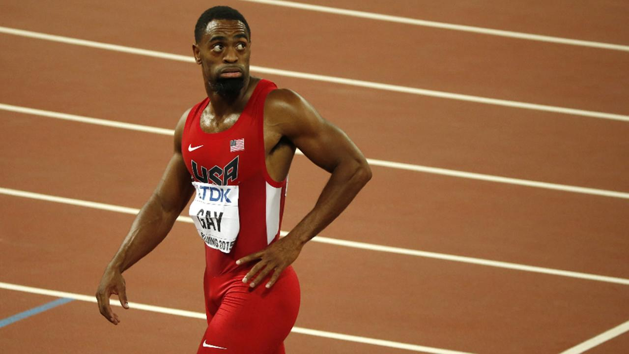 FILE: United States Tyson Gay leaves the track after the mens 100m final at the World Athletics Championships at the Birds Nest stadium in Beijing, Sunday, Aug. 23, 2015.
