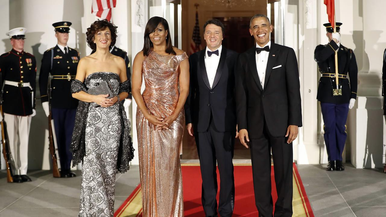 President Barack Obama and first lady Michelle Obama pose for a photo as they greet Italian Prime Minister Matteo Renzi and his wife Agnese Landini on Oct. 18, 2016.