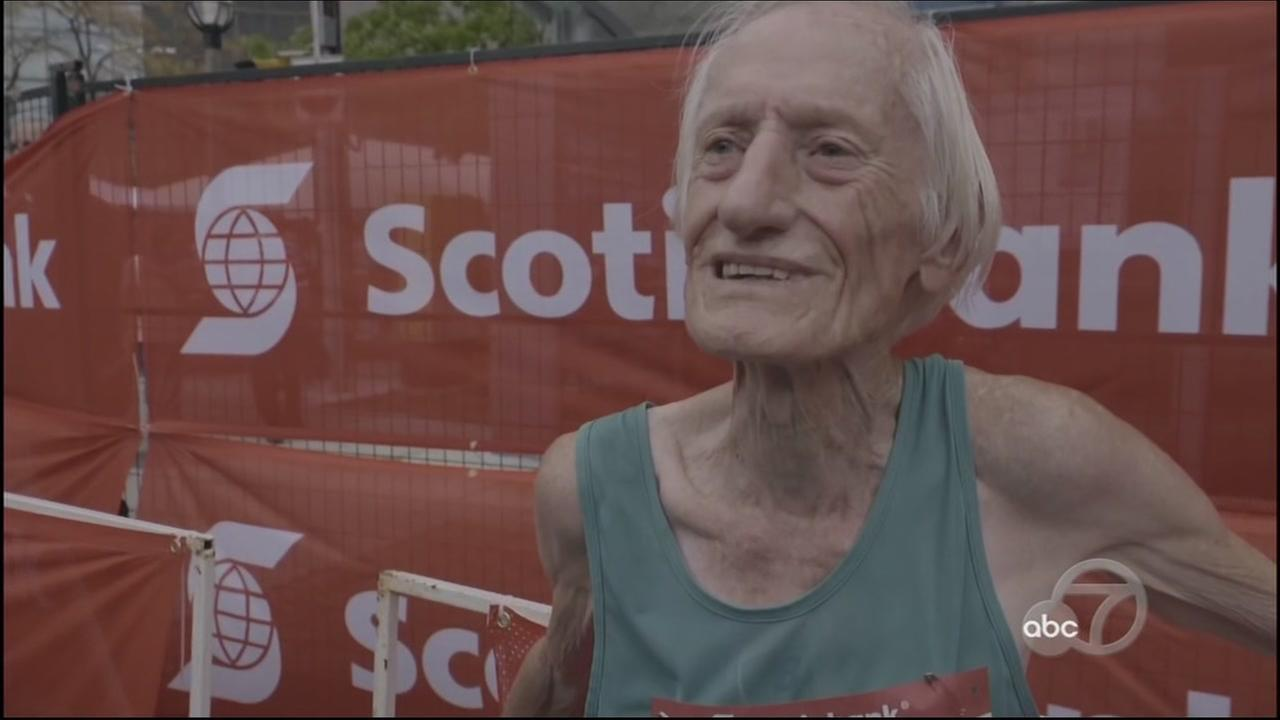 This image shows marathon runner Ed Whitlock, 85, after he finished the Toronto Marathon.
