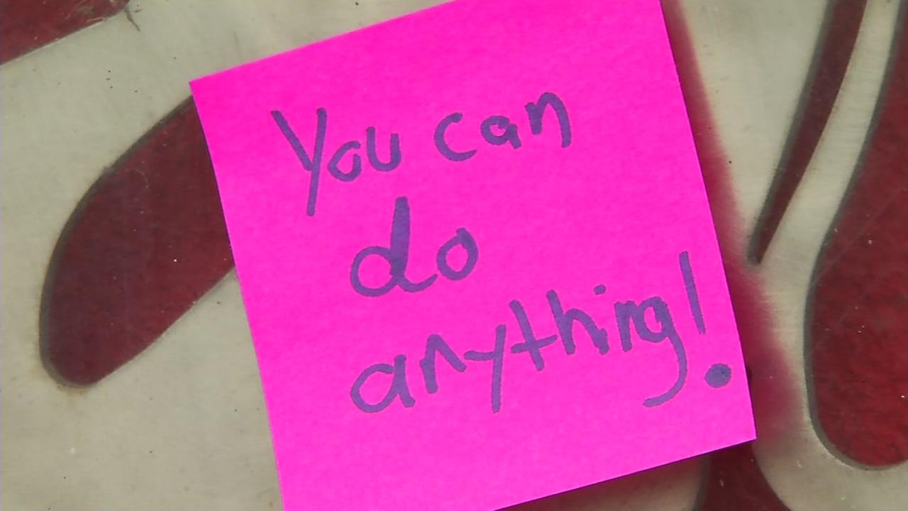 A sticky note saying, You can do anything appears on A BART station wall in San Francisco.