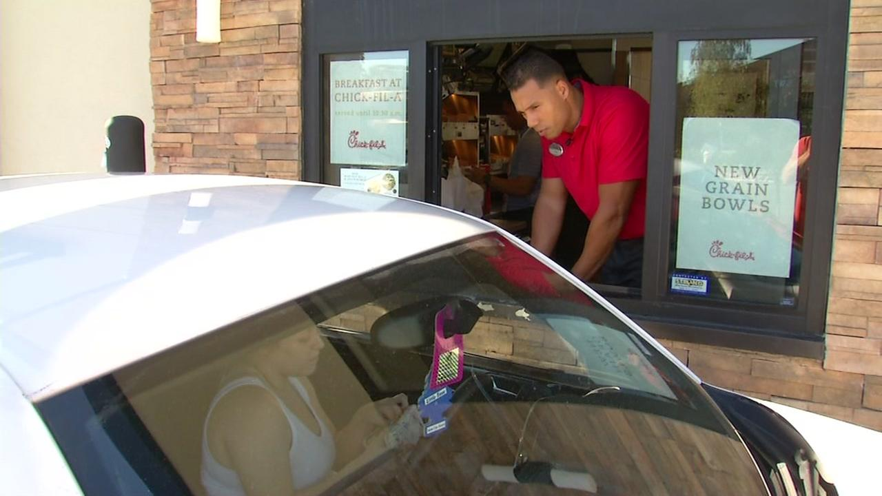 Former Raiders tight end Tony Stewart hands out orders at the Fremont Chick-Fil-A.