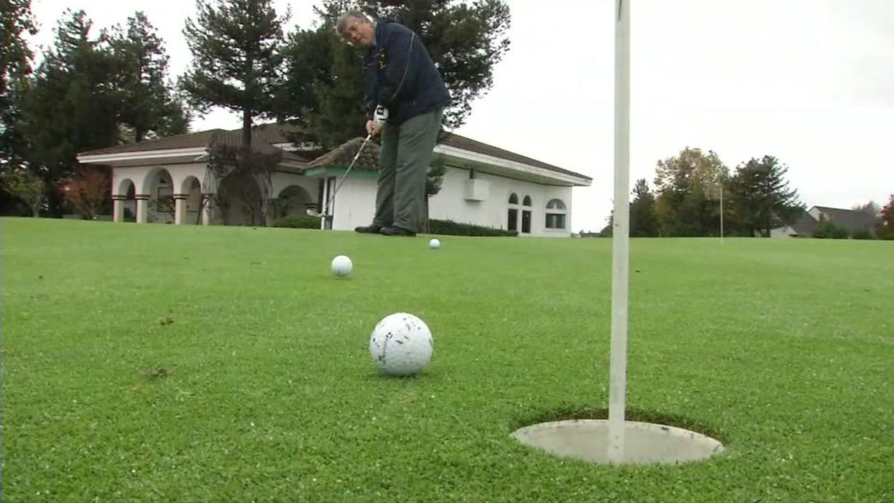 Two golf balls are seen rolling toward a hole at Adobe Creek Golf Club in Petaluma, Calif.
