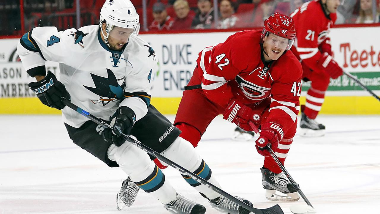 Carolina Hurricanes Joakim Nordstrom (42) and San Jose Sharks Brenden Dillon (4) skate to the puck during the second period of an NHL hockey game, Tuesday, Nov. 15, 2016.