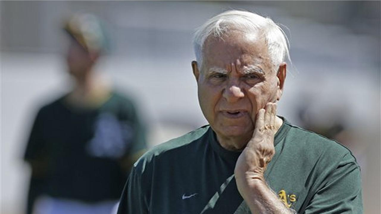 Oakland Athletics owner Lew Wolff watches players during batting practice prior to a spring training exhibition baseball game against the Texas Rangers Friday, March 27, 2015.
