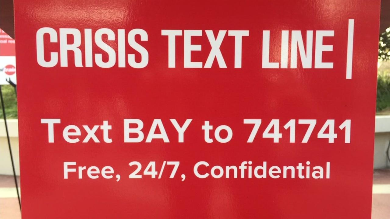 This is an undated image of a text hotline poster.