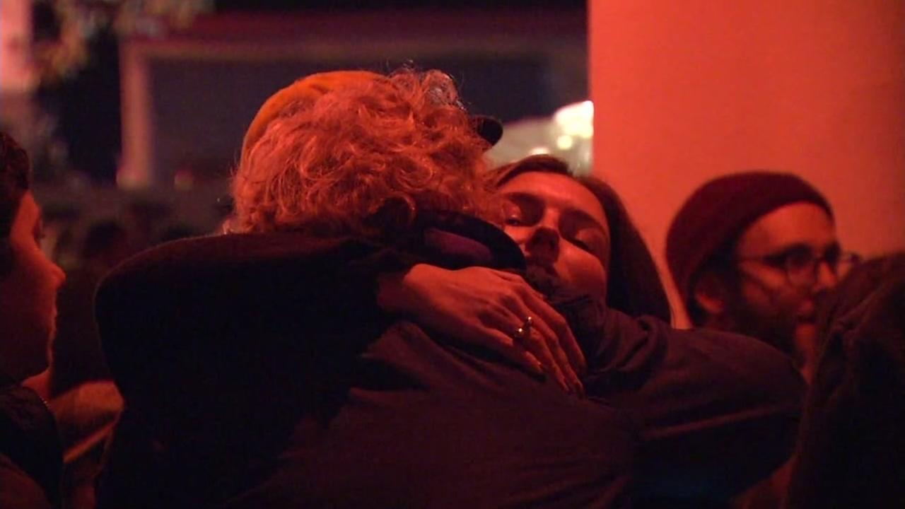 Two people hug at a vigil for the Ghost Ship fire victims in Oakland, Calif. on Dec. 5, 2016.