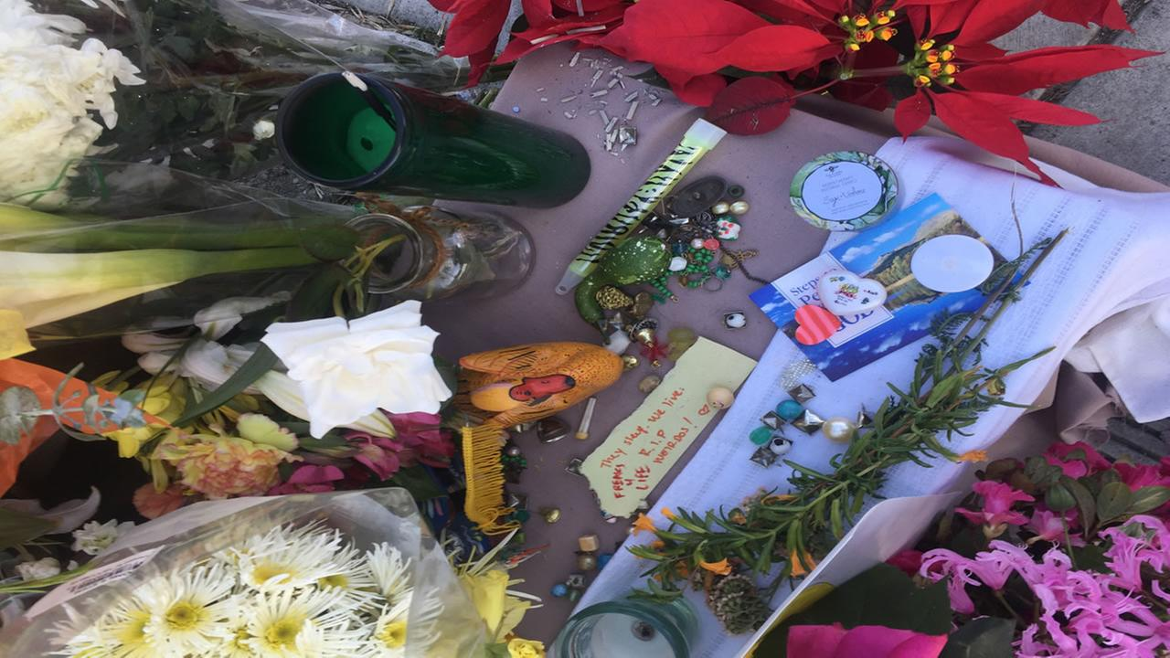 Messages, letters and offerings appear near East 12th Street and Fruitvale Ave. in Oakland, Calif. on Dec. 6, 2016.