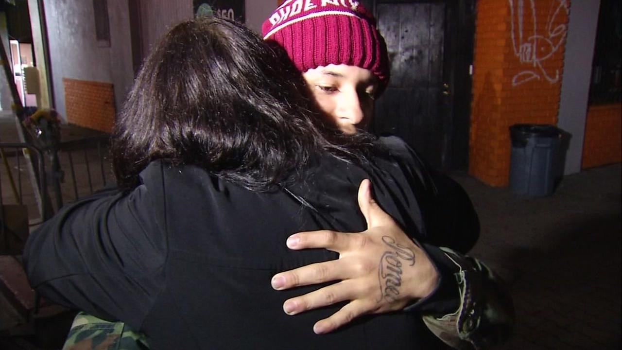 Two people hug near the scene of the Ghost Ship fire in Oakland, Calif. on Dec. 9, 2016.