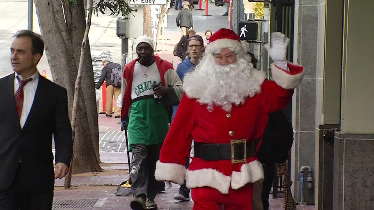 This is an undated image of a man dressed as Santa walking in San Francisco.