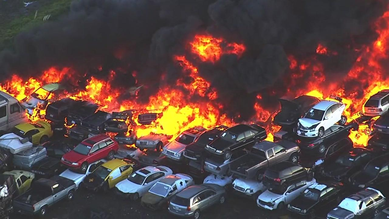 A massive fire broke out at an auto yard in Richmond, Calif. on Friday, Dec. 16, 2016.