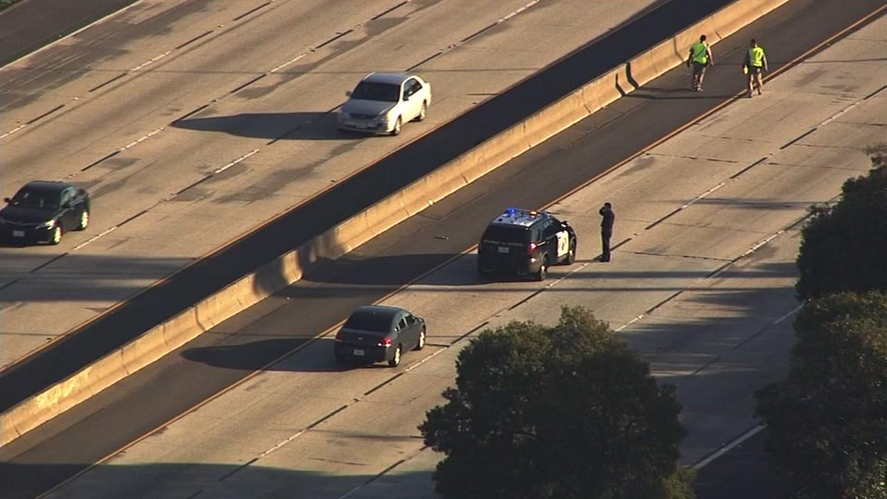 California Highway Patrol Officers search for evidence on Interstate 580 in Oakland, Calif. on Dec. 19, 2016.
