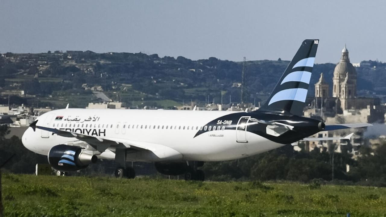 An Afriqiyah Airways plane from Libya stands on the tarmac at Maltas Luqa International airport, Friday, Dec. 23, 2016.