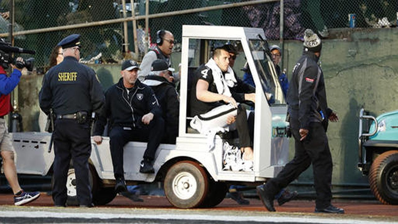 Oakland Raiders quarterback Derek Carr (4) is taken off the field in a cart during the second half against the Indianapolis Colts in Oakland, Calif., Saturday, December 24, 2016.