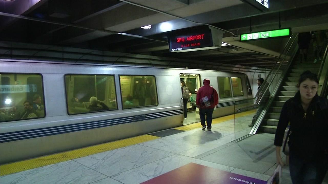 BART passengers walk into a train at Embarcadero Station in San Francisco.