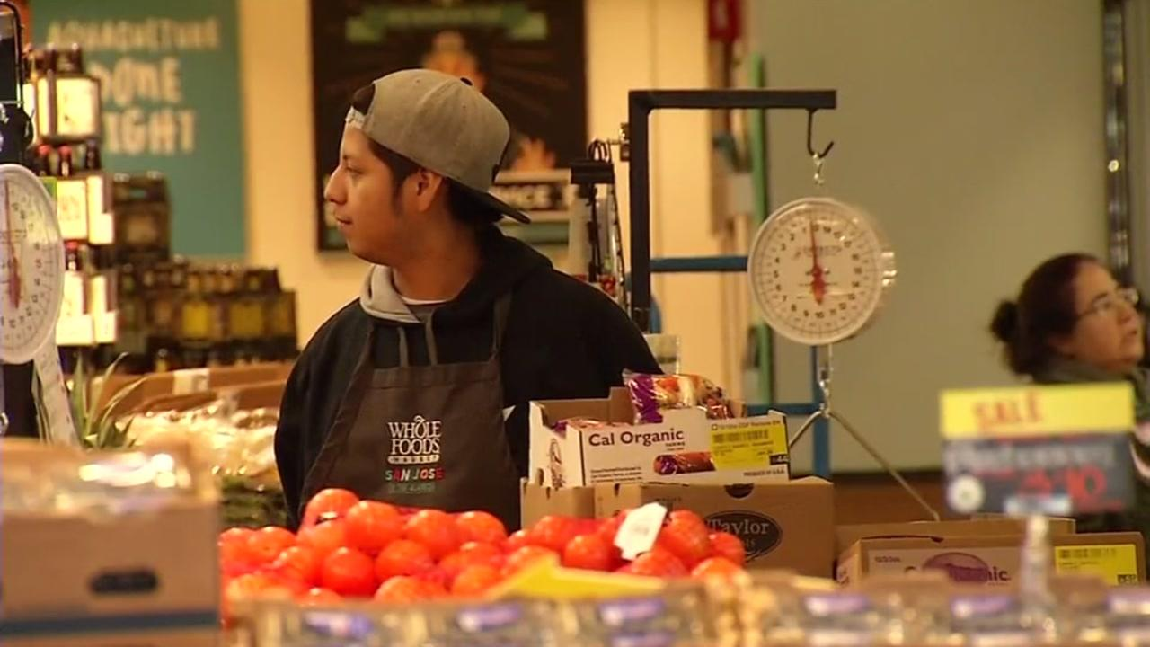 A Whole Foods employee stands at work on Monday, January 2, 2017 in San Jose, Calif.