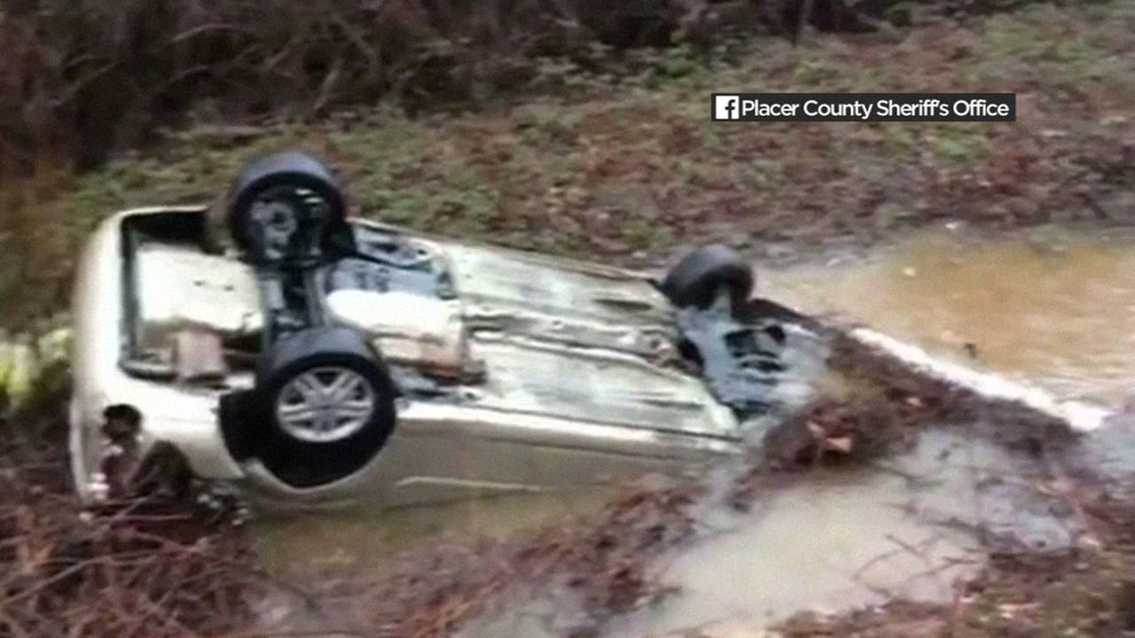 A car overturned in a creek in Placer County, Calif. during a storm on Sunday, January 8, 2017.