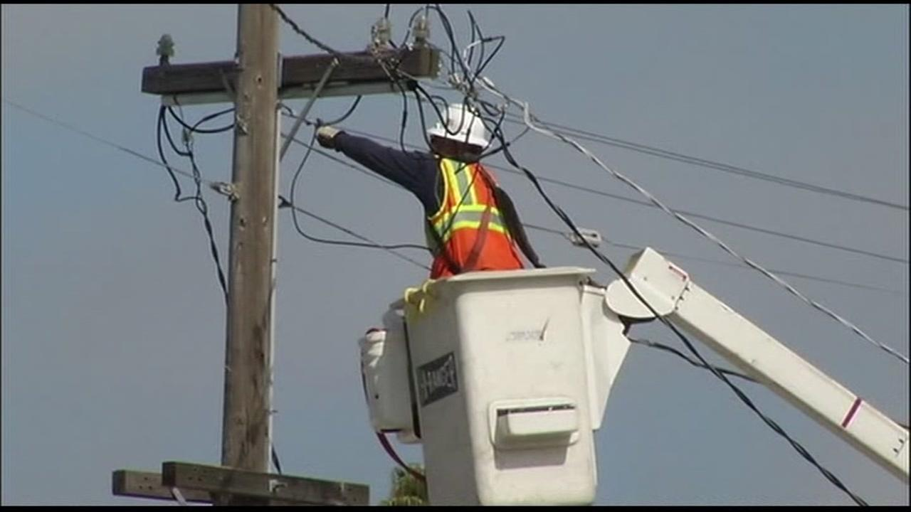 This is an undated image of a man on a PG&E cherry picker.
