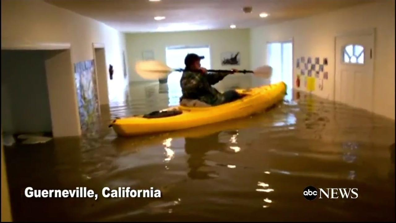 A Guerneville woman kayaks in her mothers living room after a massive storm in the Bay Area on Jan. 12, 2017.