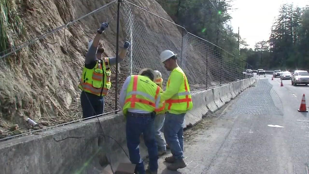 Caltrans crews install a fence along Highway 17 near Scotts Valley, Calif. on Tuesday, January 17, 2017.