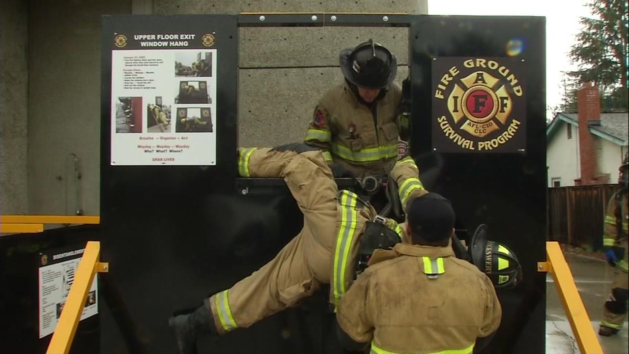 Santa Clara County firefighters participate in a survival course on Wednesday, January 18, 2017.