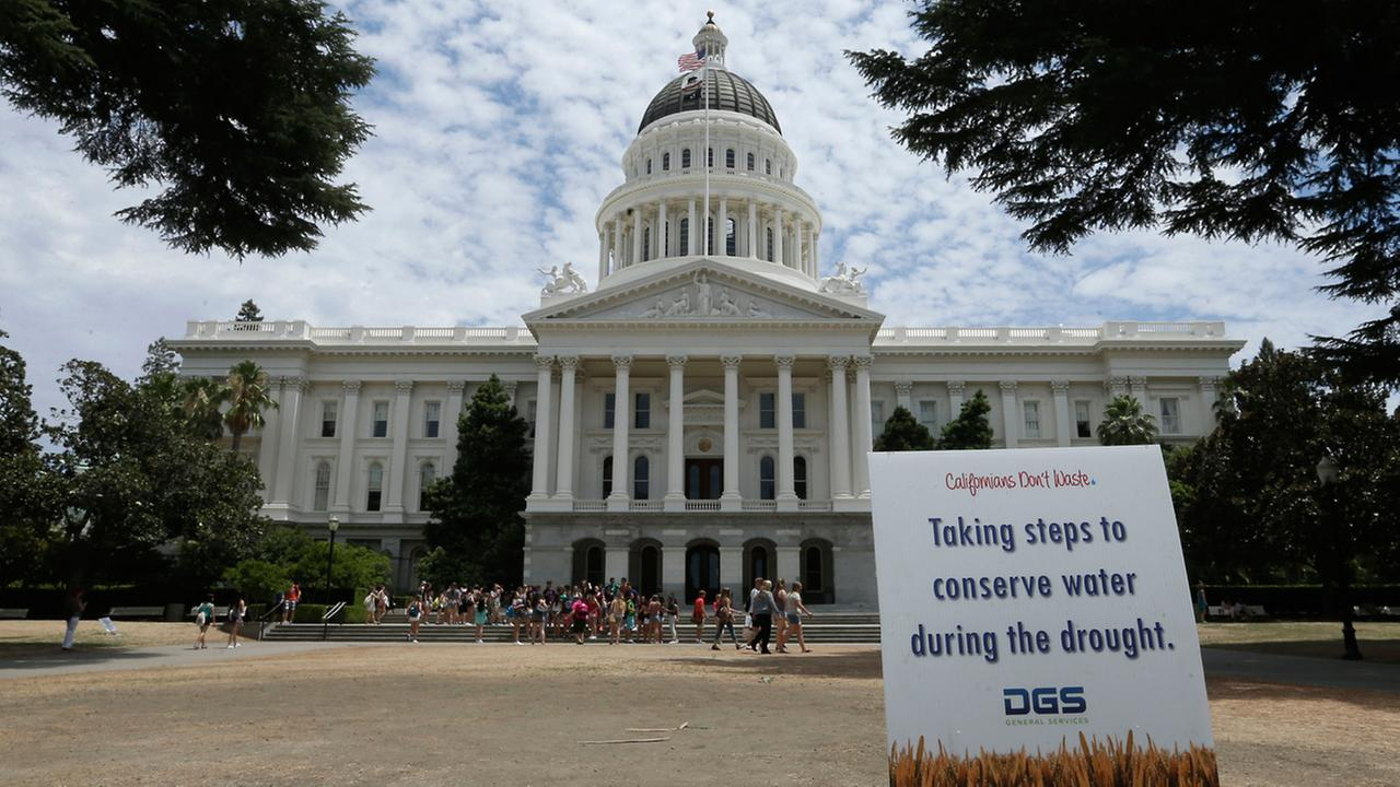 A sign alerts visitors to water conservation efforts at the state Capitol, Tuesday, July 8, 2014, in Sacramento, Calif.