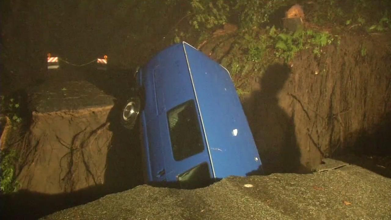 A blue van is seen stuck in a sink home in the Santa Cruz Mountains on Feb. 8, 2017.