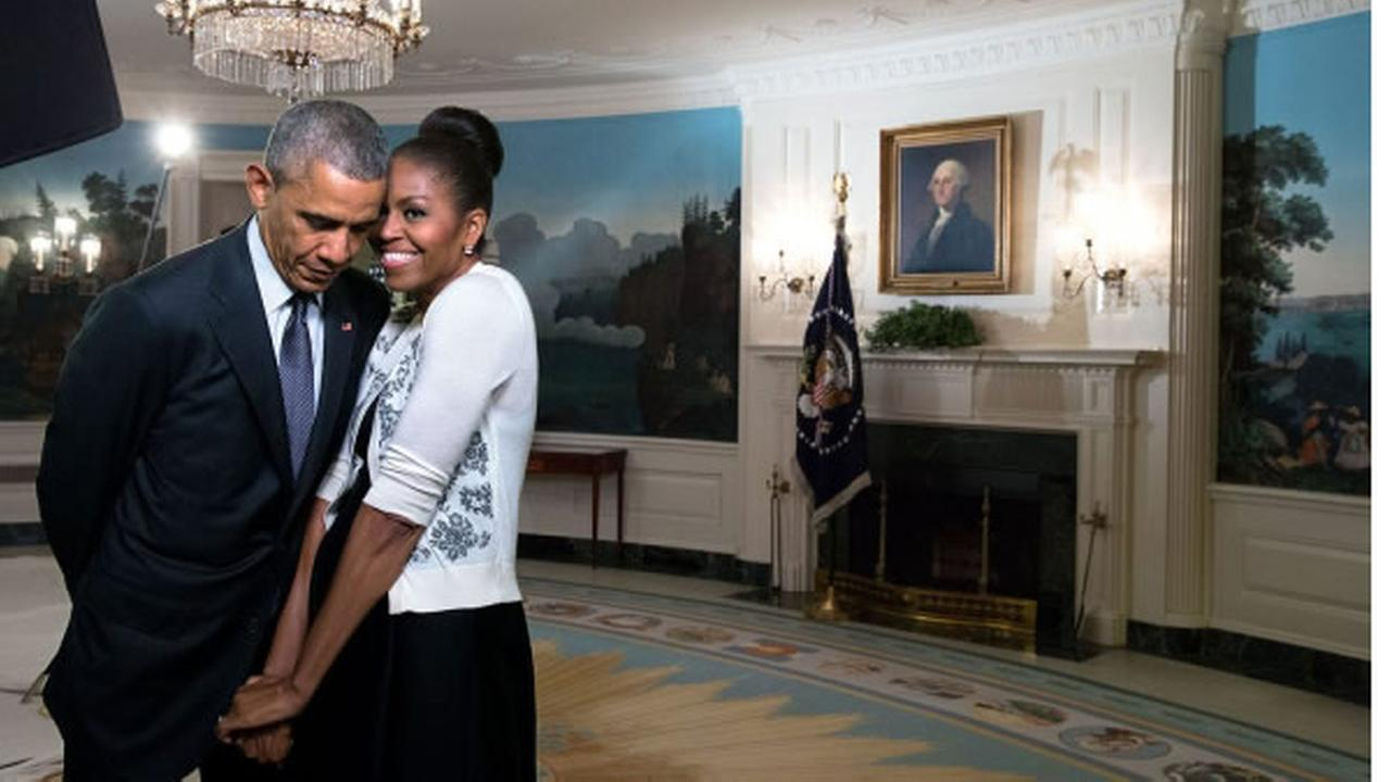 Former President Barack Obama is seen standing next to former First Lady Michelle Obama in this undated image.