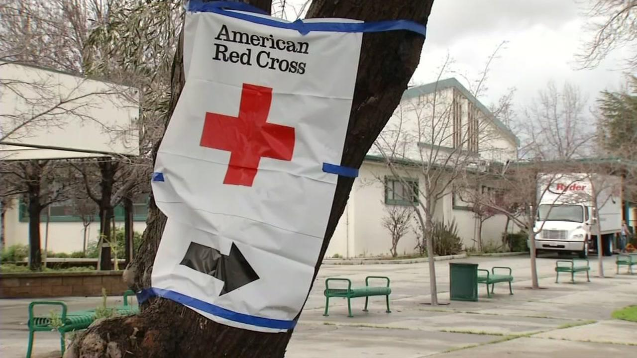 A Red Cross sign appears outside a shelter for flood evacuees in San Jose, Calif. on Feb. 21, 2017.