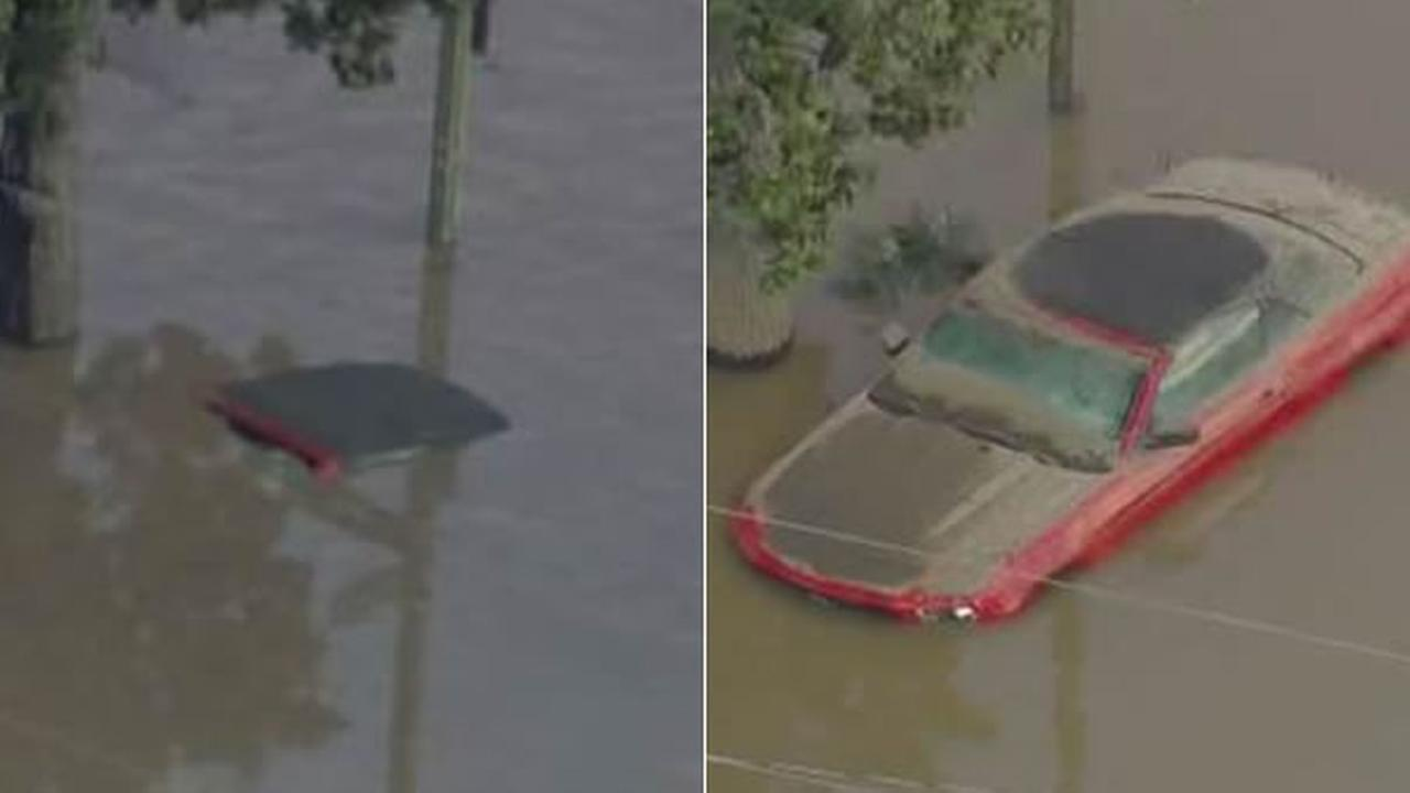 Sky7 shows a car immersed in floodwater on Tuesday, Feb. 21, 2017 (left) and again on Wednesday, Feb. 22, 2017 (right), when floodwaters receded in San Jose, Calif.