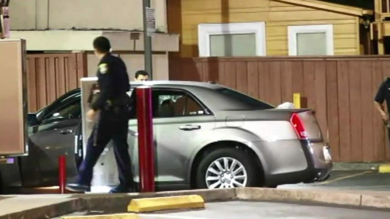 Police investigate a fatal shooting at a Wendys drive-thru in Oakland, Calif. on July 10, 2014.