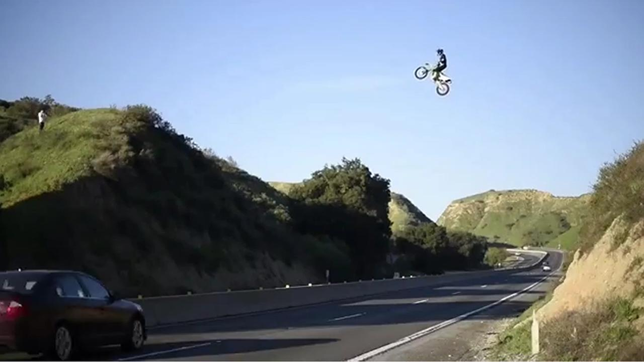 Authorities are investigating after a motorcyclist was filmed jumping over the 60 Freeway near Moreno Valley.