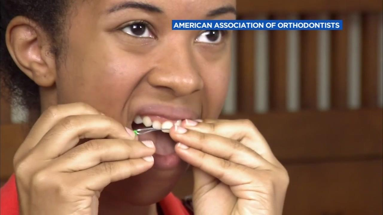 A woman demonstrates DIY braces.