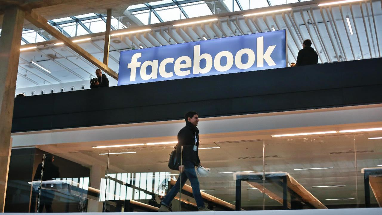 Facebook logo is displayed in a start-up companies gathering at Paris Station F, in Paris, Tuesday, Jan. 17, 2017.