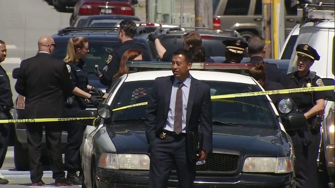 San Francisco police officials arrive on the scene of a triple shooting in the Oceanview neighborhood on March, 29, 2017.