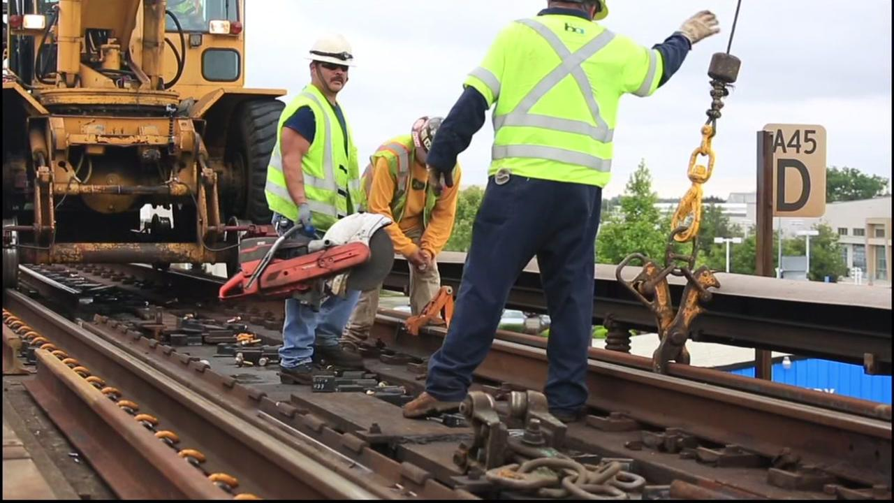 Crews repair a section of BART tracks in this undated photo.