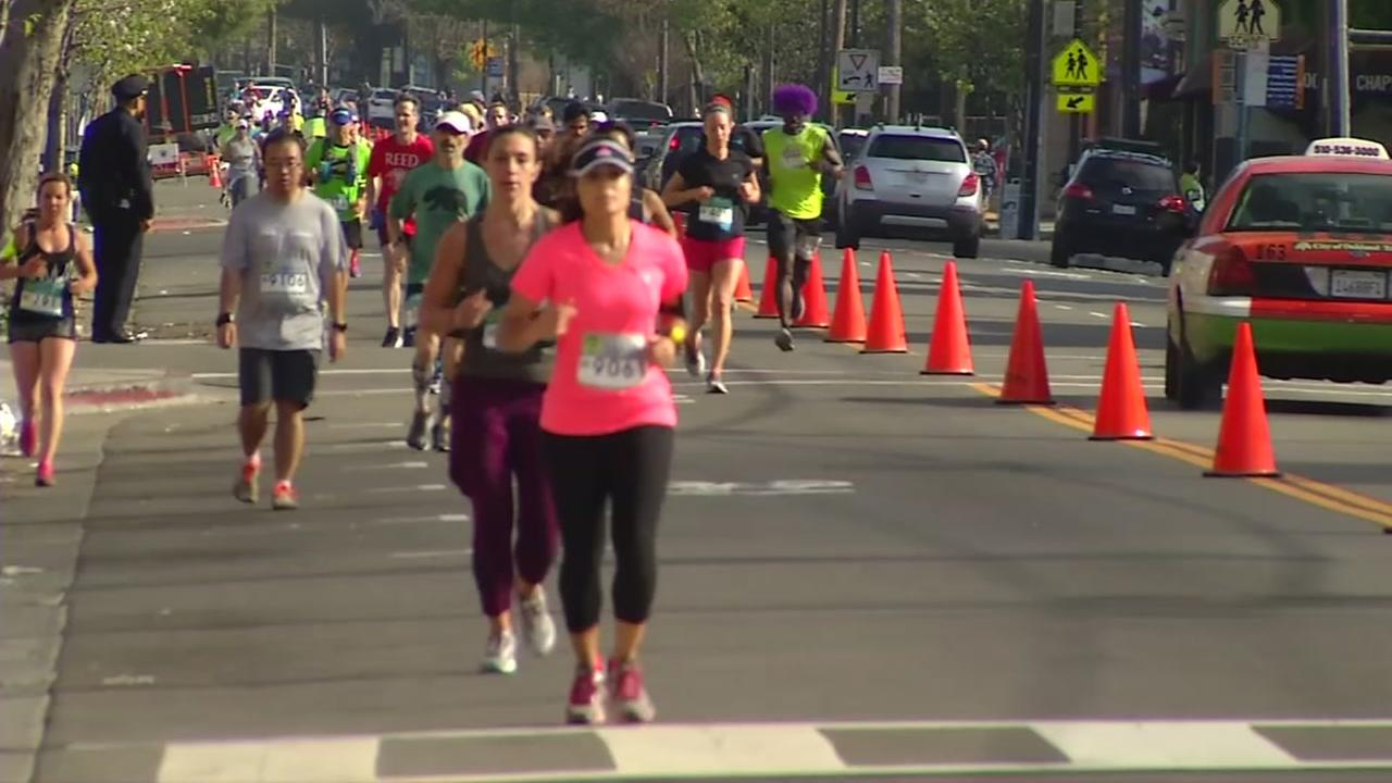Runners are seen taking part in the Oakland Marathon in Oakland, Calif. on Sunday, April 2, 2017.