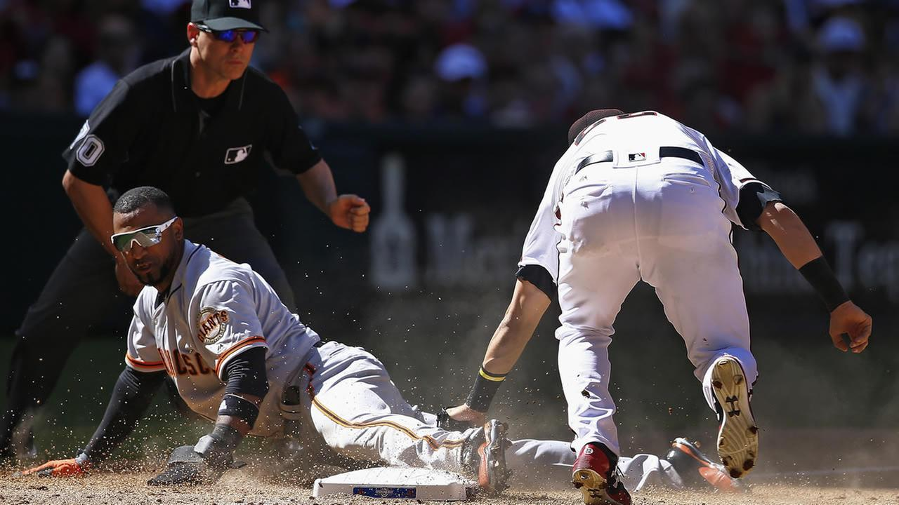 Diamondbacks Jake Lamb tags out San Francisco Giants Eduardo Nunez during the sixth inning of an opening day game on April 2, 2017, in Phoenix. (AP Photo/Ross D. Franklin)
