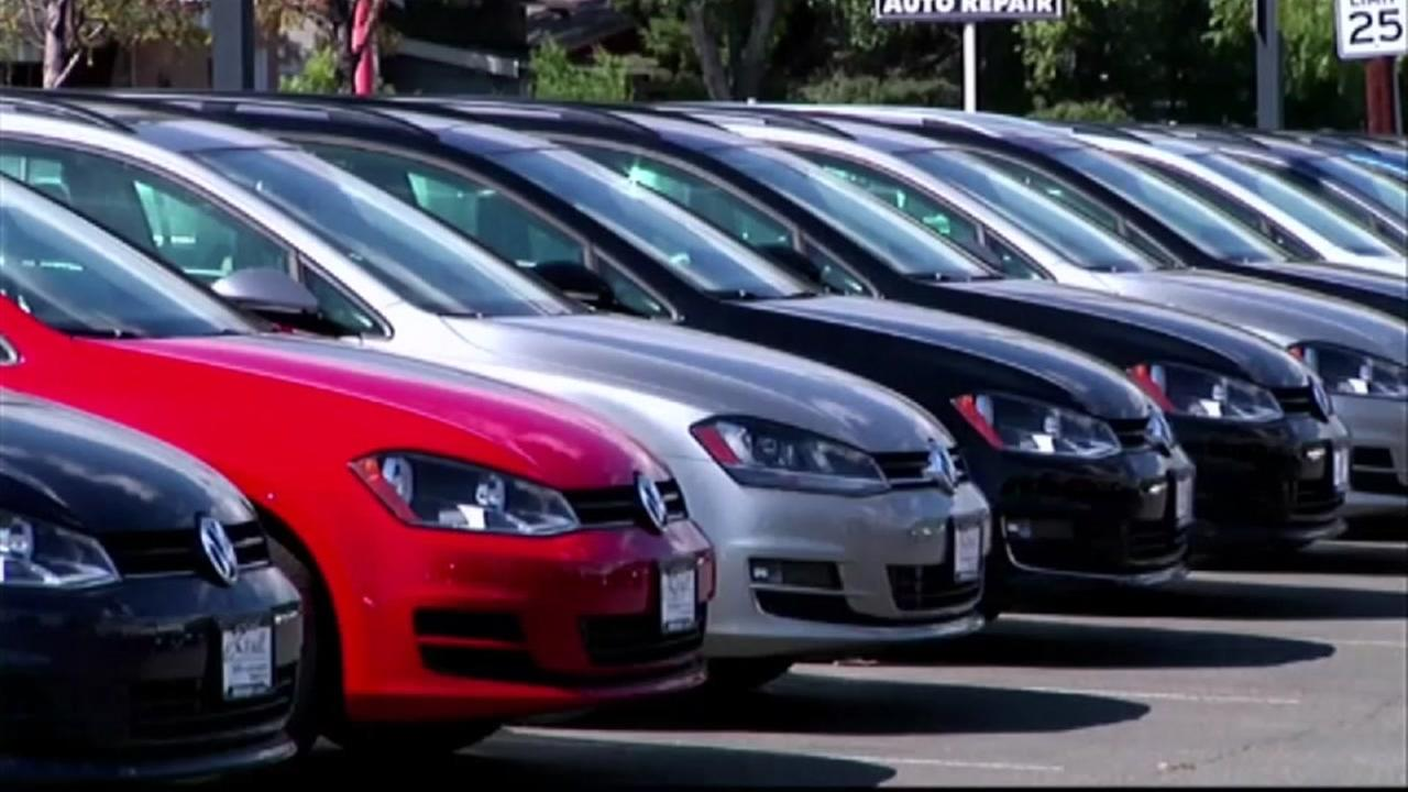 VW vehicles are seen in a car dealer parking lot in this undated image.